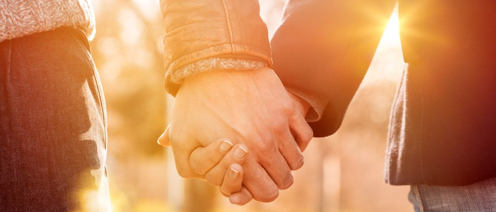 Couple holding hands on a walk together
