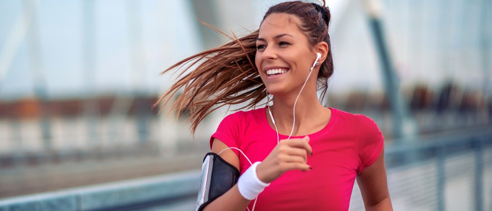 Young woman going for a nice run outside with music