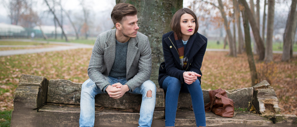 Couple having a difficult decision on a park bench