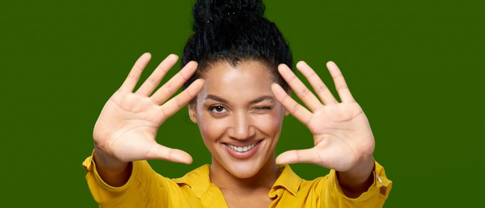 A woman winking and holding up 10 fingers in front of her
