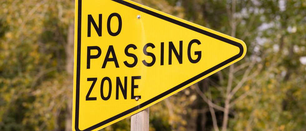 A picture of a sign that says no passing zone