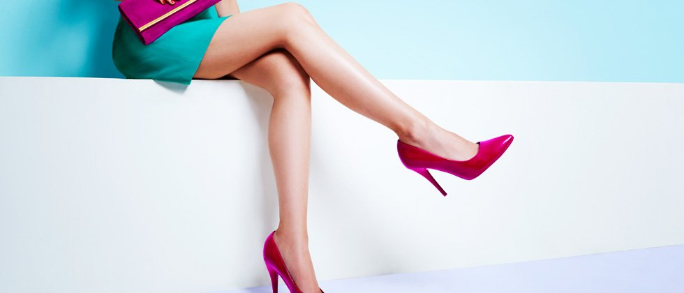 A picture of a woman's crossed legs in high heels