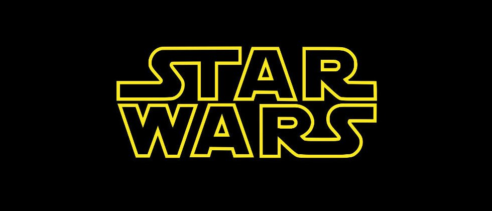 The star wars movie logo in black and gold