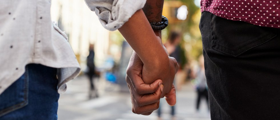 Couple walking and holding each other's hand