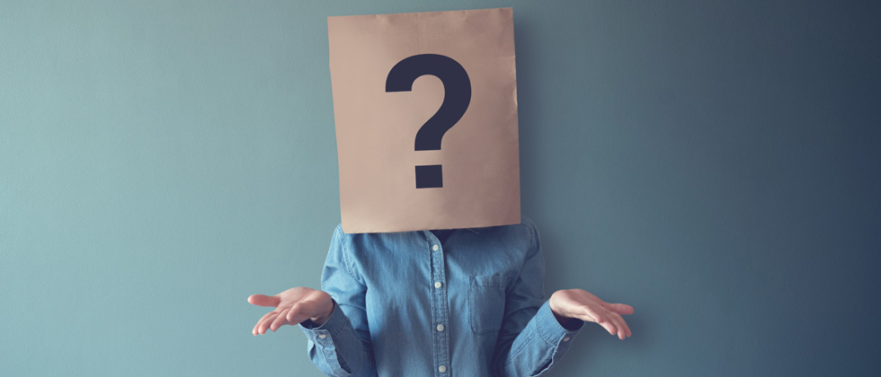A person with a brown paper bag with a question mark over their head