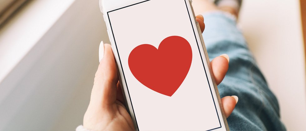 An iphone with a big heart pictured on the screen