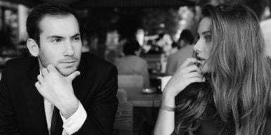 First date questions to ask on a date symbolized by two people talking to each other
