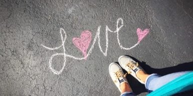 does he love me symbolized by the word love written on the street